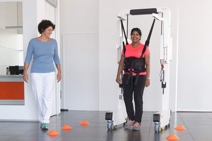 Are you wondering how Robotic devices can help patients in these challenging times of COVID-19? A recent report from Changi General Hospital (CGH), shows how the Robotics Ambulation Device helped their patient to retrain walking after a severe pneumonia.  Read more.... Changi General Hospital, Singapore recently published a very interesting case description of a lady using the Robotics Device to retrain walking after a Pneumonia. Especially in times of COVID-19, we think this article can be really helpful for all clinicians out there. The case described involves a 31-year-old patient with an arthrogryposis multiplex congenita, a rare, non-progressive congenital disease leading to multiple joint contractures and muscle weakness. For this particular patient, the disease led to scoliosis and an associated Restrictive Lung Disease. Due to this pre-condition, when she was recently hospitalized with pneumonia, she needed ventilator support and ICU care. Following release to the general ward, the patient was unable to ambulate further than 3m, even with physical support and she had a dependency on oxygen. And here is where the Robotics Device came in. Referred to an inpatient rehabilitation program, the Robotics Device permitted the patient to start walking training despite her conditions and by the 6th session, she was able to walk over 300m with only minimal body weight support. This improvement also transferred to her everyday life, as she is able to walk 80m with a walking stick and no longer depends on additional oxygen supply. In this case, the Robotics Device provided exactly the safe and permissive environment that was needed to allow overground gait training. It provided just enough support to permit the training, but only as much as needed, so that gains in walking ability transferred to walking outside of the device. The authors of the case report conclude that gait training performed with the Robotics Device facilitates pulmonary rehabilitation and recommended 